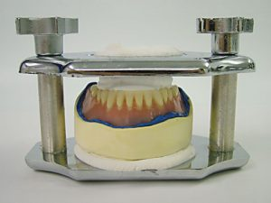 Pour and place denture in reline jig as usual for acrylic reline